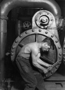 431px-lewis_hine_power_house_mechanic_working_on_steam_pump